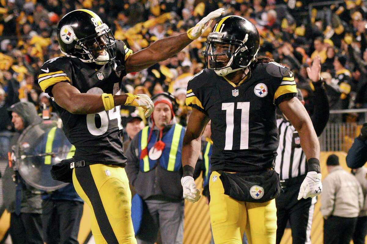 FILE - In this Dec. 20, 2015, file photo, Pittsburgh Steelers wide receiver Markus Wheaton (11) celebrates with wide receiver Antonio Brown (84) after scoring a touchdown during the second half of an NFL football game against the Denver Broncos, in Pittsburgh. (AP Photo/Don Wright, File) ORG XMIT: NY165