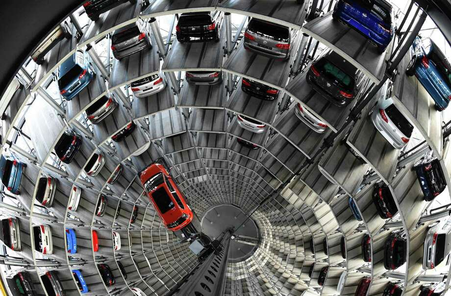 A VW Golf car is seen inside the so-called car towers of car manufacturer Volkswagen AG. Volkswagen in September admitted that it had installed software created to cheat on emissions tests in 11 million of its diesel vehicles worldwide. Photo: AFP / Getty Images File Photo / AFP