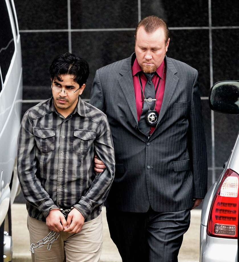 Omar Faraj Saeed Al-Hardan (left) is escorted by U.S. Marshals from the Bob Casey Federal Courthouse on  Jan. 8, 2016, in Houston. Al Hardan made his initial appearance in federal court in Houston on Friday morning after he was indicted on three charges related to accusations he tried to provide material support to the Islamic State group. Photo: Bob Levey /Associated Press / FR156786 AP