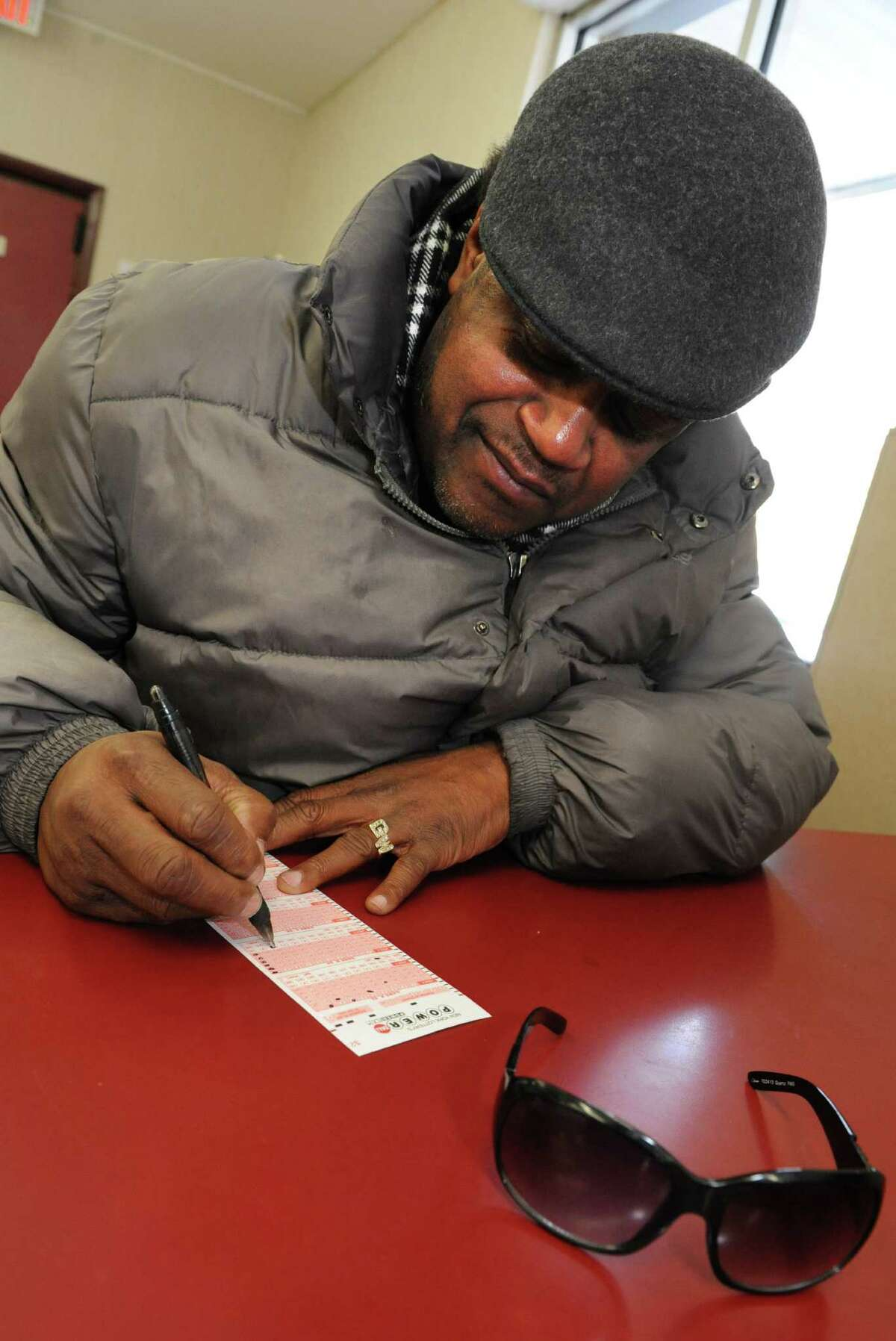 Customer Jay White of Albany fills out a Powerball form at a Stewart's shop on Albany Shaker Road on Friday, Jan. 8, 2016 in Loudonville, N.Y. The Powerball lottery game is now $800 Million. (Lori Van Buren / Times Union)