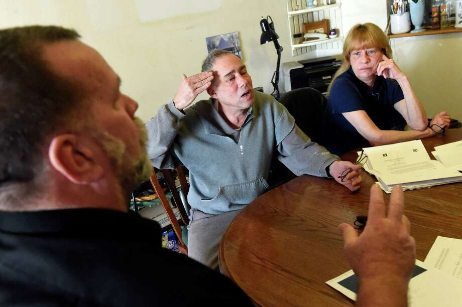 Tenants Paul Zostant, left, Chris Torre, center, and his wife Diane Torre talk about changes taking place on Wednesday, Jan. 6, 2016, at Bridgewater Apartments in Milton, N.Y. (Cindy Schultz / Times Union) Photo: Cindy Schultz / 10034889A