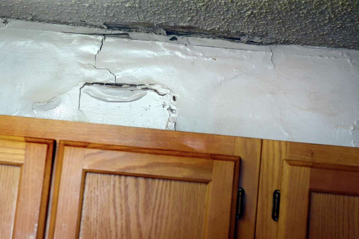 Water damage from the upstairs apartment is still in need of repair after six years in Chris and Diane Torre's kitchen on Wednesday, Jan. 6, 2016, at Bridgewater Apartments in Milton, N.Y. (Cindy Schultz / Times Union)