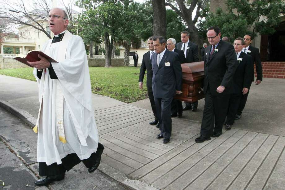 Christ Episcopal Church Rector Patrick Gahan and pallbearers take the casket of former Alamo Heights sophmore David Molak, 16, from Christ Episcopal Church on Friday. Photo: Marvin Pfeiffer /San Antonio Express-News / San Antonio Express-News