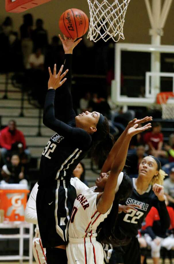 Steele's Antonia Anderson (32) goes up for a shot against Wagner's Nyjah Meadows (20) at Wagner High School on Friday, Jan. 8, 2016. (Kin Man Hui/San Antonio Express-News) Photo: Kin Man Hui, Staff / San Antonio Express-News / ©2016 San Antonio Express-News