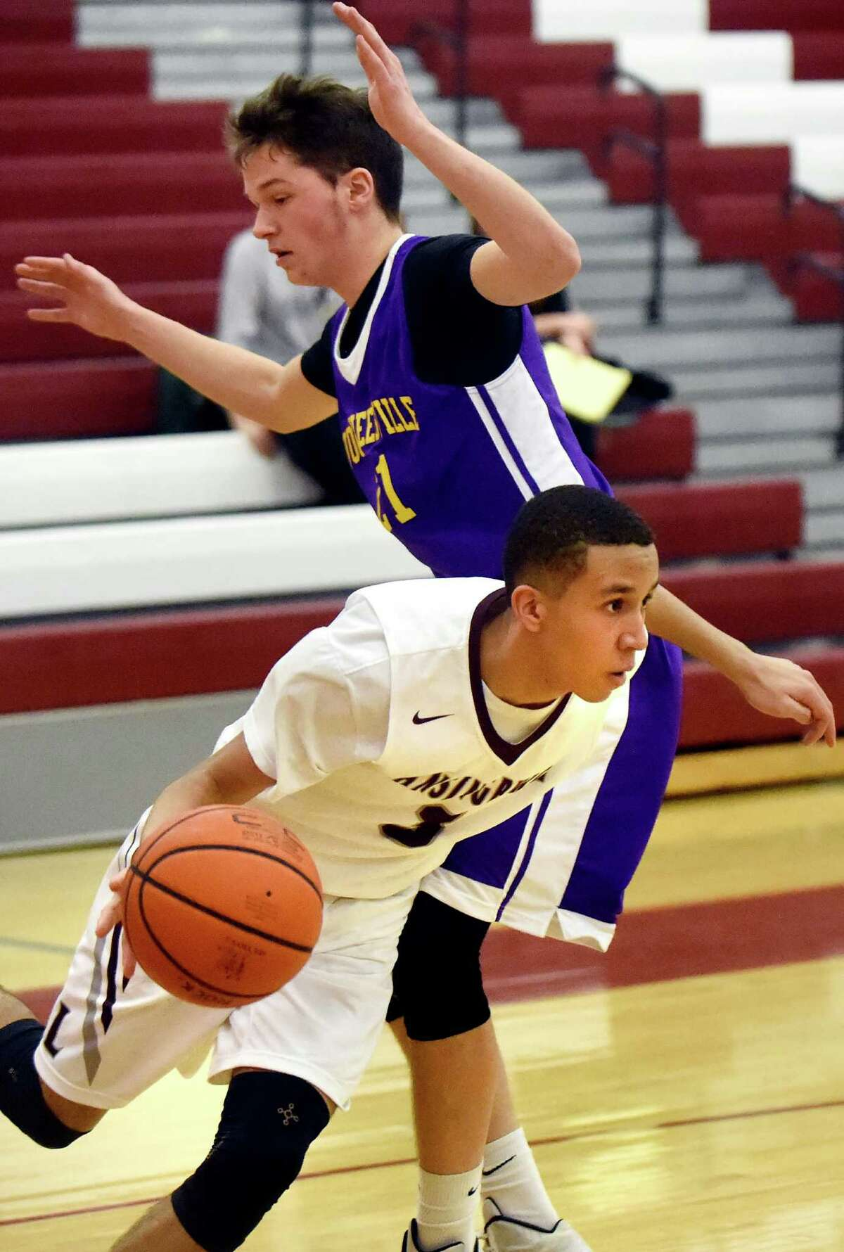 Lansingburgh's Jio Canty, in front, drives around Voorheesville's Alex Giordano during their basketball game on Friday, Jan. 8, 2016, at Lansingburgh High in Lansingburgh, N.Y. (Cindy Schultz / Times Union)