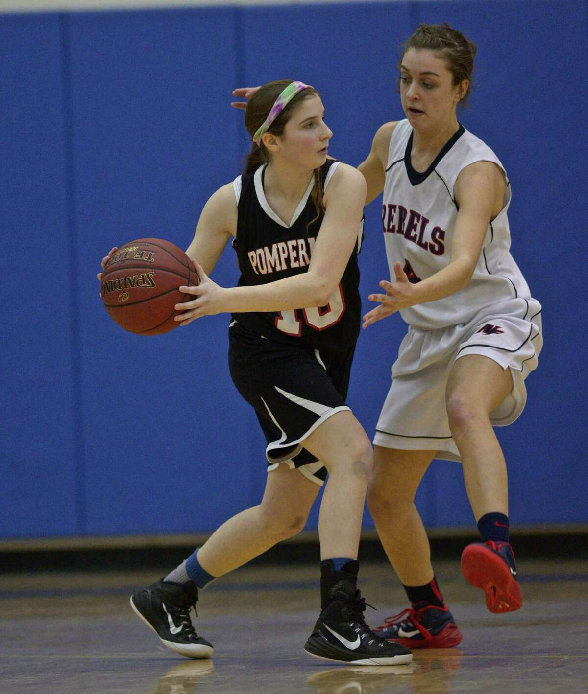 FILE PHOTO: New Fairfield's Bridget Zima (4) guards Pomperaug's Lauren Rubinstein (10) during the SWC Girls Basketball Championship Semifinal game between Pomperaug and New Fairfield high schools, played at Newtown High School, Newtown, Conn, on Tuesday, February 24, 2015.
