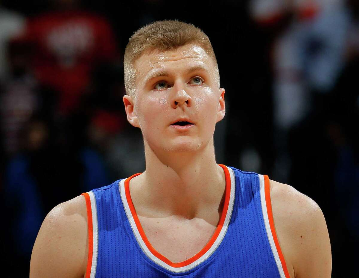 ATLANTA, GA - JANUARY 05: Kristaps Porzingis #6 of the New York Knicks looks on during the game against the Atlanta Hawks at Philips Arena on January 5, 2016 in Atlanta, Georgia. NOTE TO USER User expressly acknowledges and agrees that, by downloading and or using this photograph, user is consenting to the terms and conditions of the Getty Images License Agreement. (Photo by Kevin C. Cox/Getty Images) ORG XMIT: 575728783
