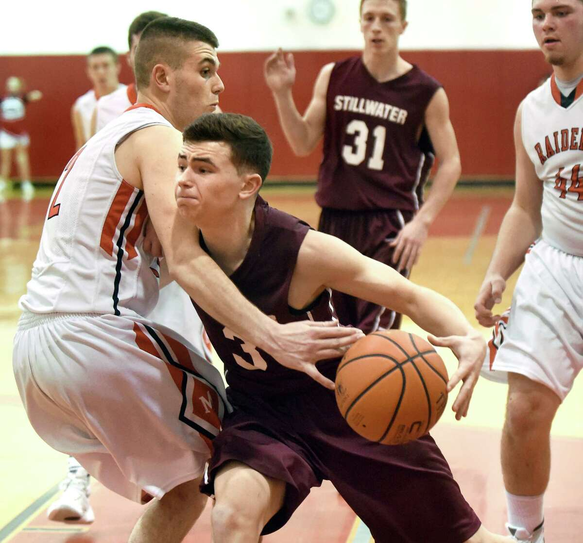 Stillwater's Jared D'Aloia, center, controls the ball as Mechanicville's Jonathan Pickett defends and fouls during their basketball game on Friday, Jan. 8, 2016, at Mechanicville High in Mechanicville, N.Y. (Cindy Schultz / Times Union)