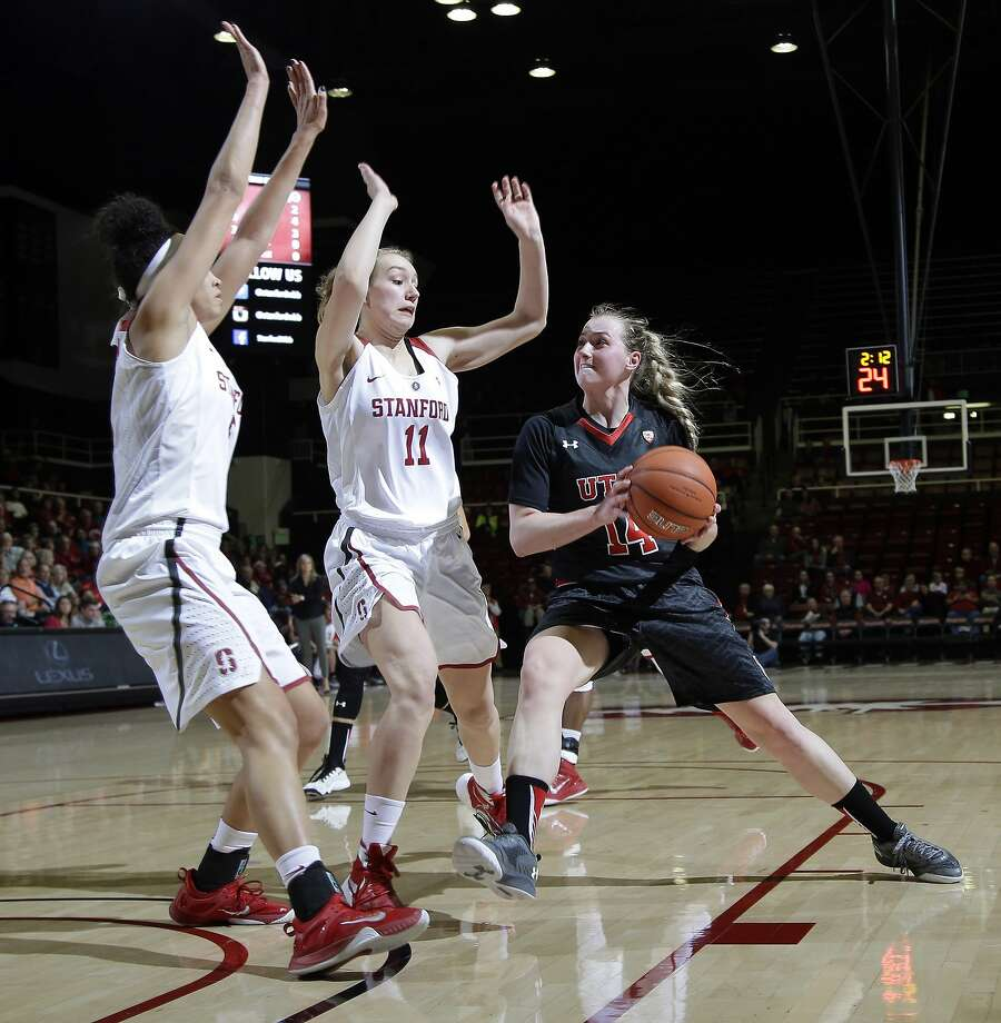 Utah guard Paige Crozon is defended by Stanford forwards Alanna Smith (11) and Kaylee Johnson. Photo: Marcio Jose Sanchez, Associated Press