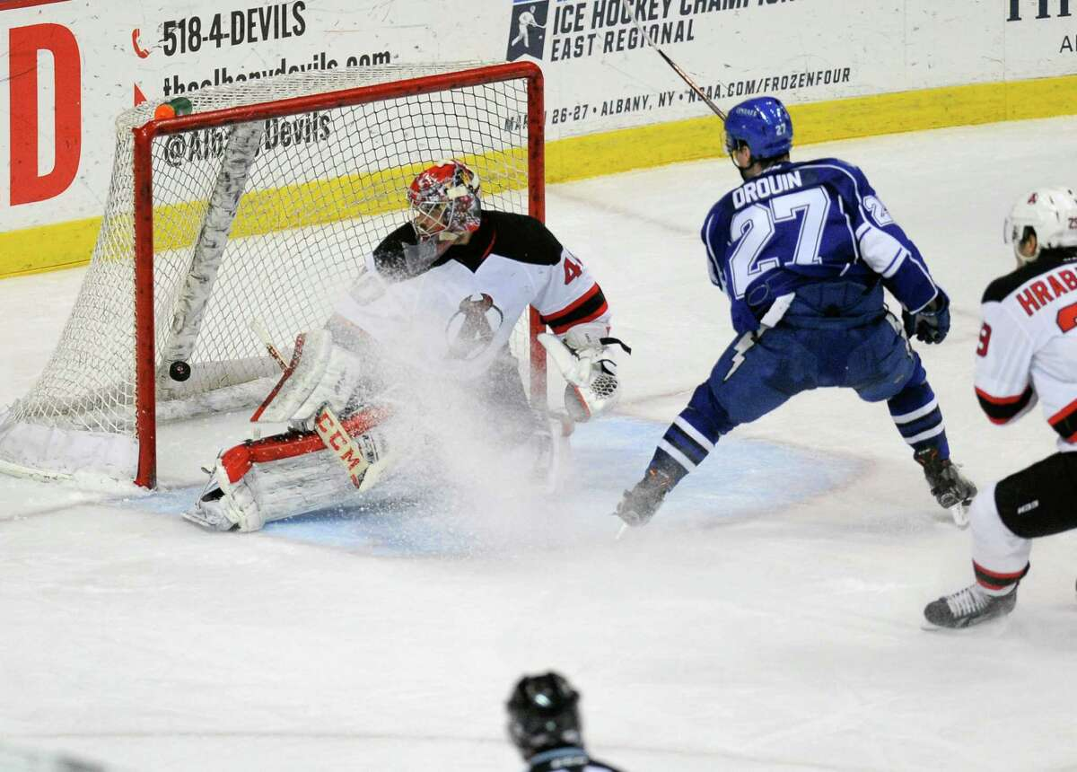 Syracuse Crunch's Jonathan Drouin (27) scores against Albany Devils goaltender Yann Danis (40) during the first period of an AHL hockey game in Albany, N.Y., Friday, Jan. 8, 2016. (Hans Pennink / Special to the Times Union) ORG XMIT: HP101