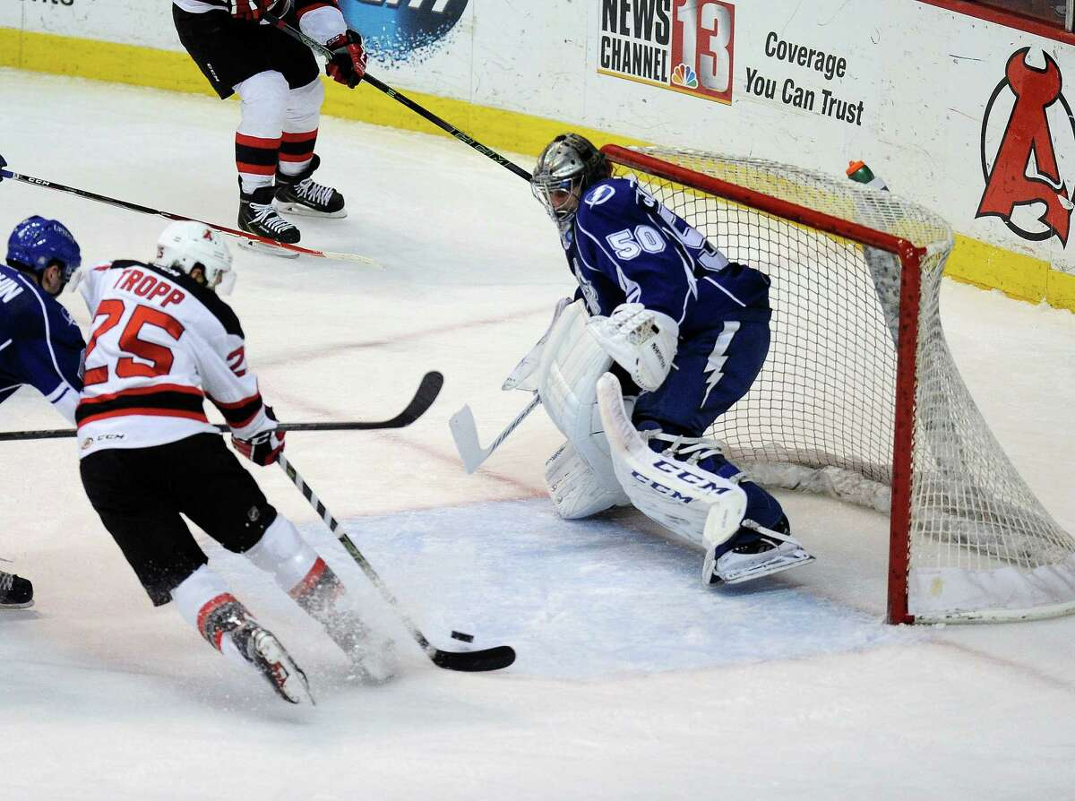 Albany Devils' Corey Tropp (25) scores against Syracuse Crunch goaltender Kristers Gudlevskis (50) during the first period of an AHL hockey game in Albany, N.Y., Friday, Jan. 8, 2016. (Hans Pennink / Special to the Times Union) ORG XMIT: HP103