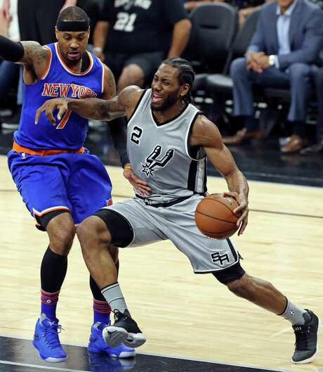 San Antonio Spurs' Kawhi Leonard looks for room around New York Knicks' Carmelo Anthony during first half action Friday Jan. 8, 2016 at the AT&T Center. Photo: Edward A. Ornelas, Staff / San Antonio Express-News / © 2016 San Antonio Express-News