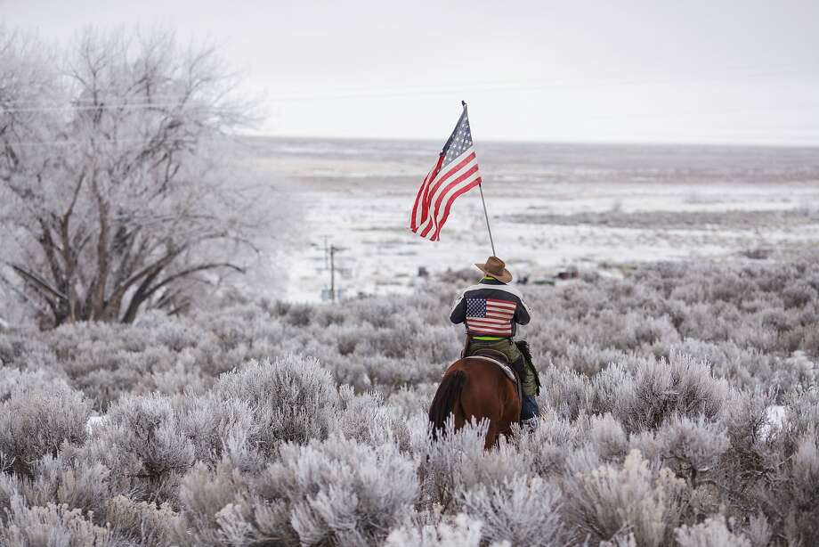 Duane Ehmer rides his horse Hellboy at the occupied Malheur National Wildlife Refuge on the sixth day of the occupation of the federal building in Burns, Oregon on January 7, 2016. The leader of a small group of armed activists who have occupied a remote wildlife refuge in Oregon hinted on Wednesday that the standoff may be nearing its end.  Photo: Rob Kerr, AFP / Getty Images