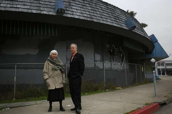 Architects Joyce Roy and Leal Royce Charonnat stand in front of closed Biff's Diner, the building they are trying to save Jan. 8, 2015 in Oakland, Calif.