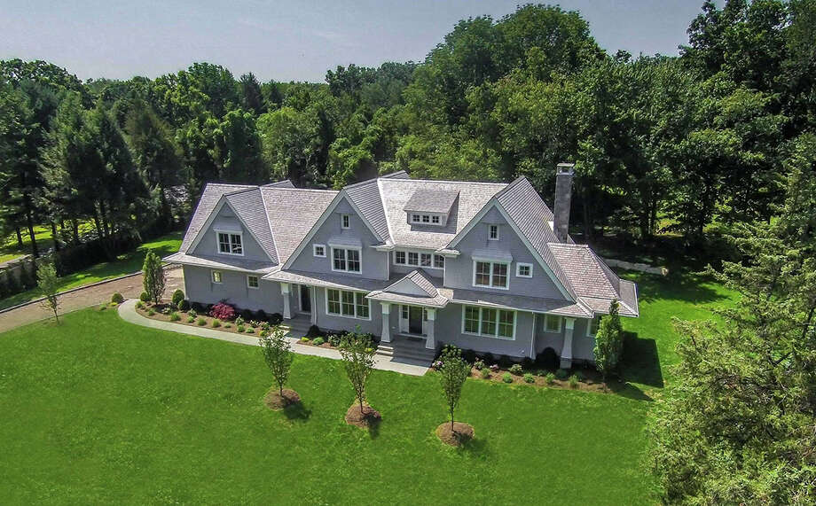 New Colonial at 1461 Merwins Lane is on the market for $1,895,000. The 5,063-square-foot home sits on two acres in the Greenfield Hill neighborhood. Photo: Contributed Photos / Fairfield Citizen
