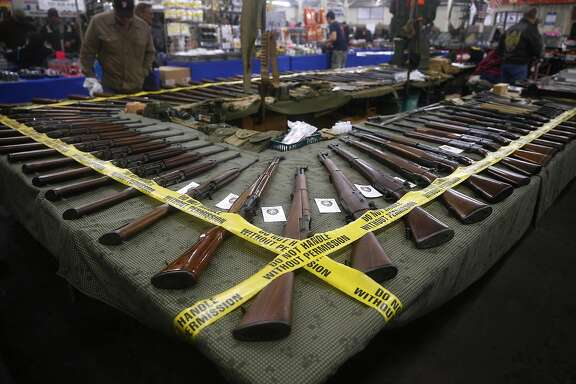 Rifles are displayed by a vendor at the Crossroads of the West gun show at the Cow Palace in Daly City, Calif. on Saturday, Jan. 9, 2016.