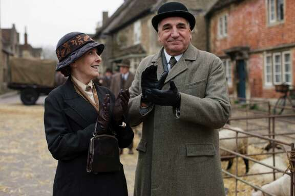 A day outside the Abbey! In regular clothes! Mrs. Hughes (Phyllis Logan) and Mr. Carson (Jim Carter).