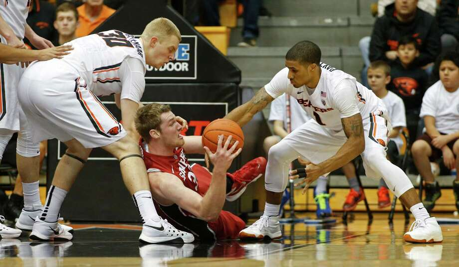 Stanford's Grant Verhoeven, center, grabs a loose ball from Oregon State's Olaf Schaftenaar, left, and Gary Payton II during the first half of an NCAA college basketball game in Corvallis, Ore., on Wednesday, Jan. 6, 2016. (AP Photo/Timothy J. Gonzalez) Photo: Timothy J. Gonzalez / Associated Press / FR11177 AP