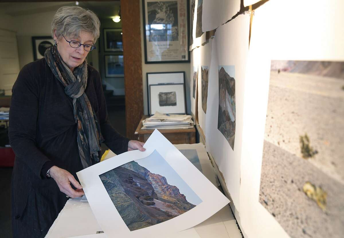Photographer Deborah O'Grady sorts images from her latest project at her home in Berkeley, Calif. on Thursday, Jan. 7, 2016. O'Grady was commissioned to photograph landscapes to accompany a St. Louis Symphony performance of Olivier Messiaen's