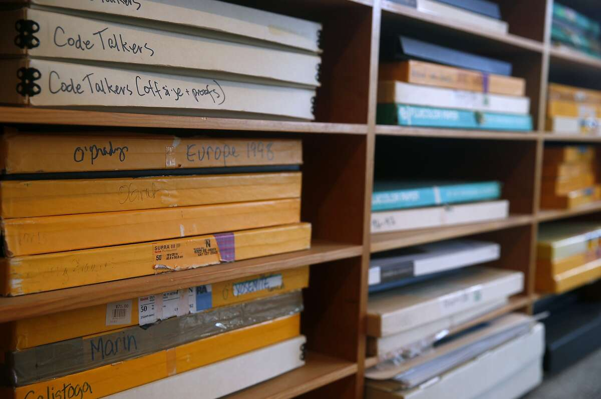 Photographer Deborah O'Grady stores boxes of prints from previous projects at her home in Berkeley, Calif. on Thursday, Jan. 7, 2016. O'Grady was commissioned to photograph landscapes to accompany a St. Louis Symphony performance of Olivier Messiaen's