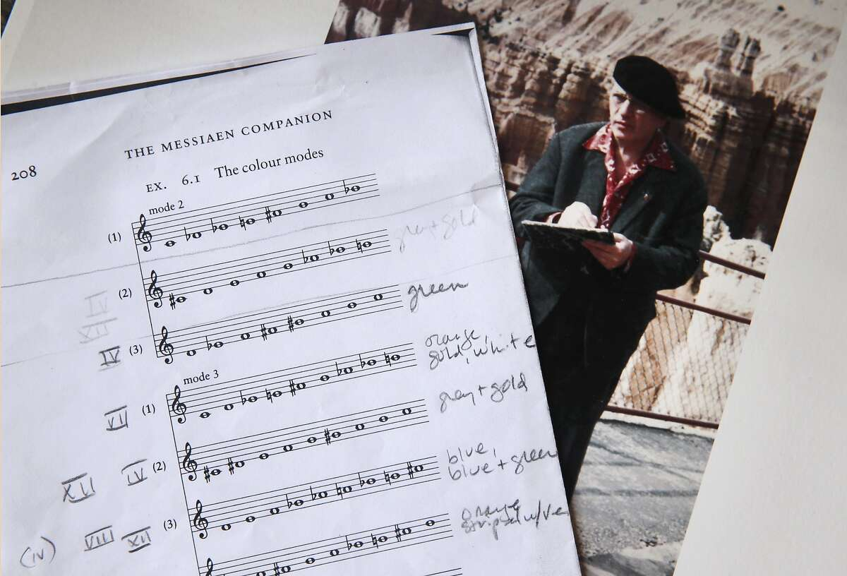 An annotated music sheet and photo of composer Olivier Messiaen is displayed at photographer Deborah O'Grady's home in Berkeley, Calif. on Thursday, Jan. 7, 2016. O'Grady was commissioned to photograph landscapes to accompany a St. Louis Symphony performance of Messiaen's