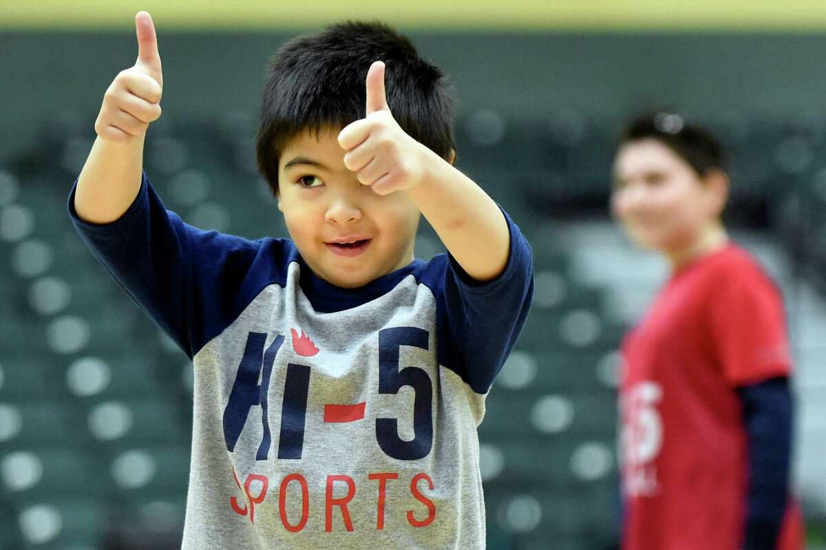 Lorenzo Gonzalo, 5, of Ballston Lake gives the thumbs up sign to his father during the annual Hi-5 Sports basketball game against the Siena women's team on Saturday, Jan. 9, 2016, at Siena College in Loudonville, N.Y. Hi-5 Sports offers sports training for children and adults with special needs in order to build self-esteem, confidence and friendships. (Cindy Schultz / Times Union)
