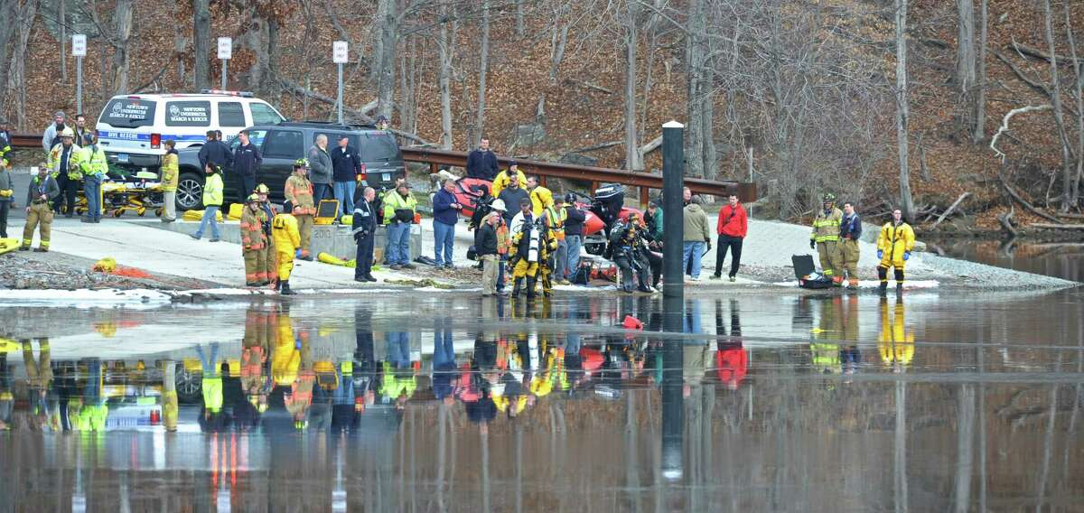 Divers try to determine if there are occupants inside a vehicle that police said crashed into Lake Lillinonah in Bridgewater Saturday afternoon. Trooper Kelly Grant said that the vehicle was submerged in the lake near the Bridgewater boat launch. Saturday, January 9, 2016, in Bridgewater, Conn.