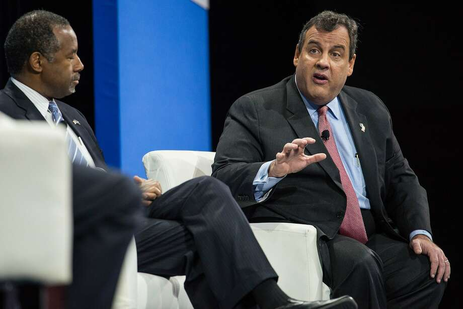 Republicans Ben Carson (left) and New Jersey Gov. Chris Christie discuss their positions during a forum in Columbia, S.C., which was moderated by House Speaker Paul Ryan, R-Wis. Photo: Sean Rayford, Associated Press