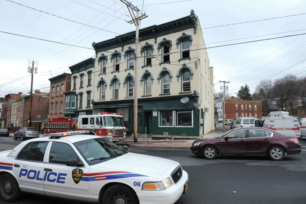 Troy police and fire work the scene of a fire at 349 Congress Street on Saturday Jan. 9, 2016 in Troy, N.Y. (Michael P. Farrell/Times Union)