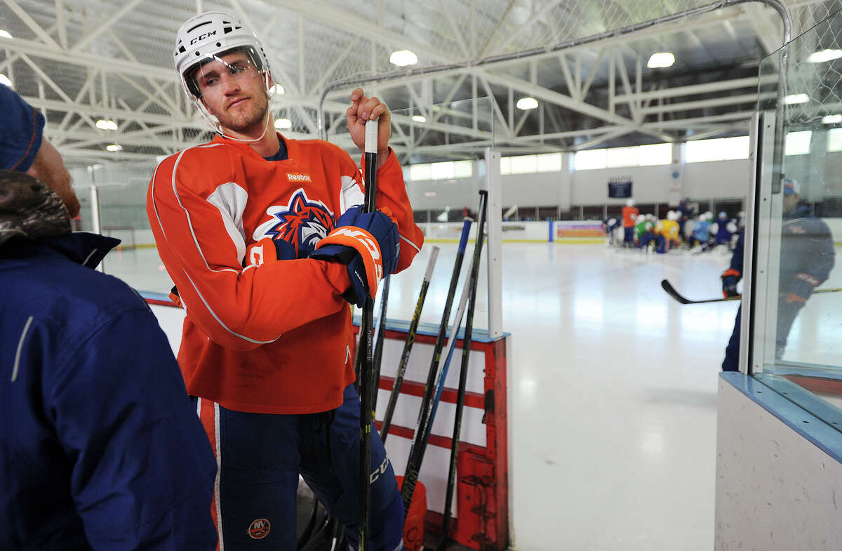 Bridgeport Sound Tiger Justin Florek prepares to take to the ice during his team's practice at the Wonderland of Ice in Bridgeport, Conn. on Tuesday, January 5, 2016. The two rinks at the facility are in high demand during the winter season. The AHL team has practiced at the facility for five years.