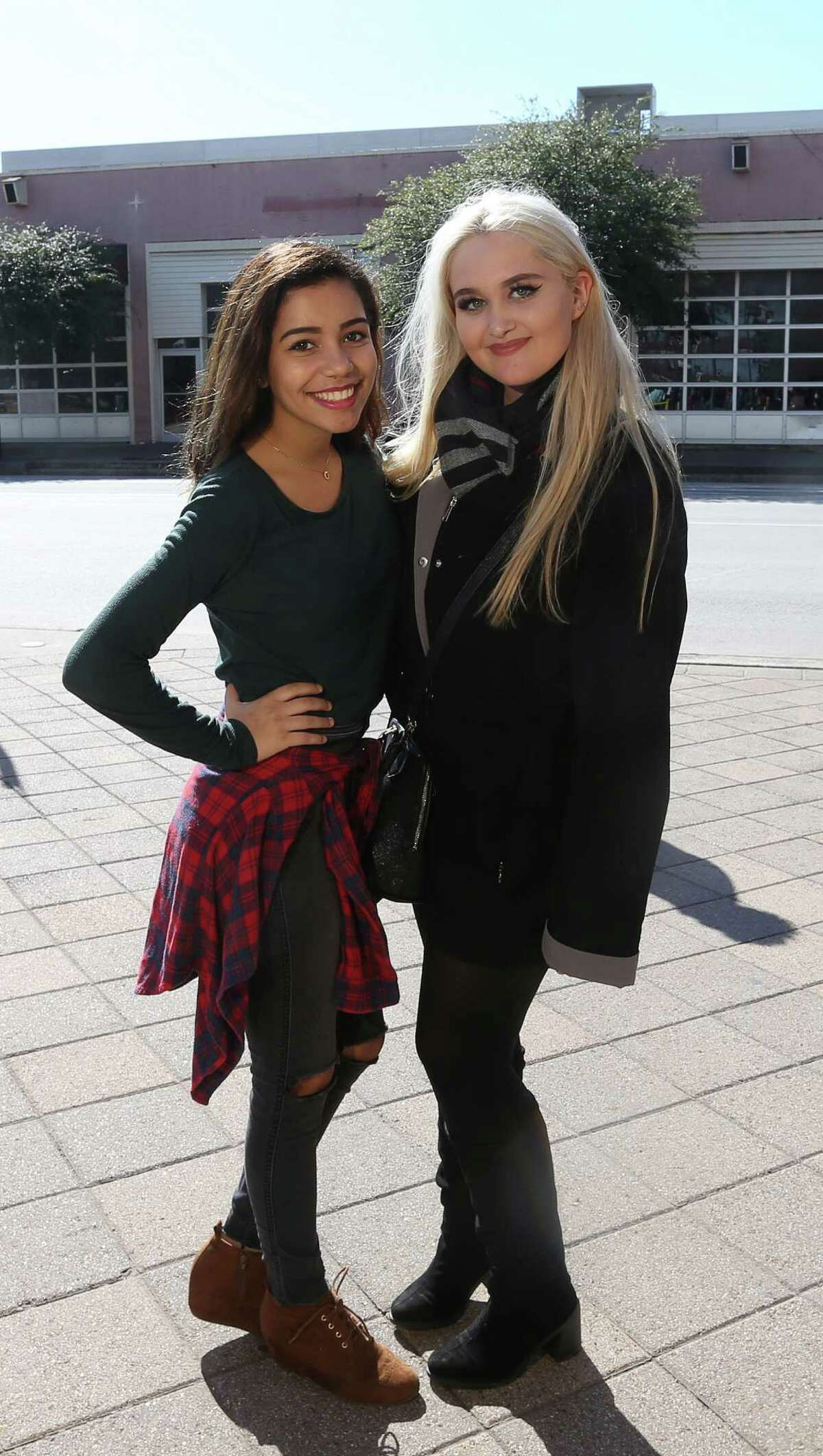 People pose for a photo while waiting in line to audition for The Voice at Minute Maid Park Saturday, Jan. 9, 2016, in Houston.