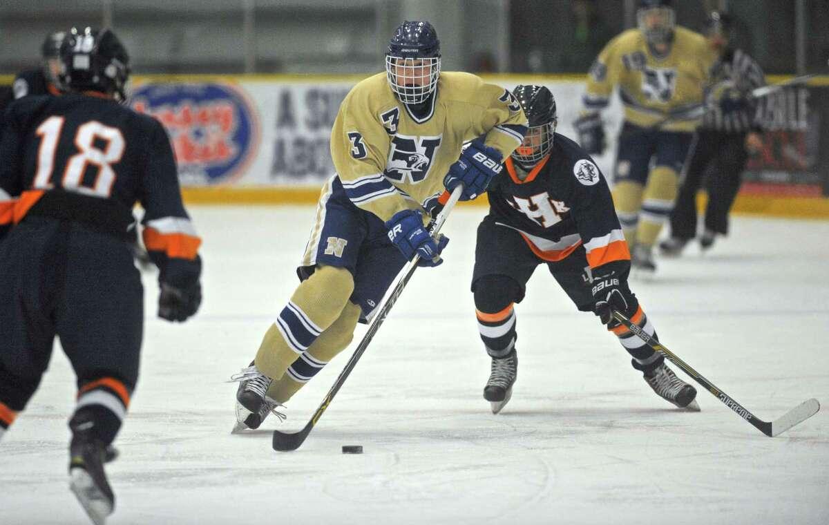 Newtown's Devin Marsh (3) splits Lyman Hall's Markus Trahan (18) and Josh Matinez (2) during the boys hockey game between Lyman Hall/H-K/Coginchaug and Newtown, on Saturday, January 9, 2016, in the Danbury Ice Arena, in Danbury, Conn.
