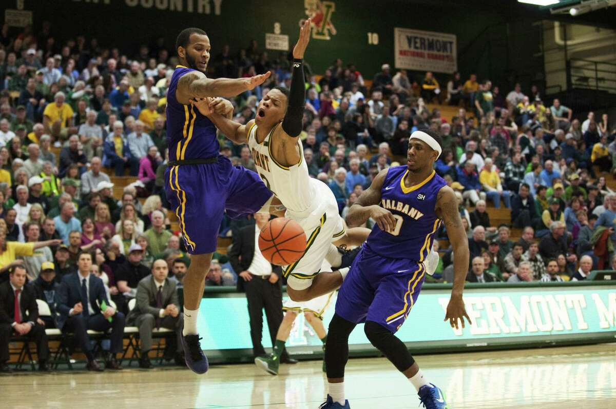 Catamounts Guard Trae Bell-Haynes (2) is fouled as he leaps for a lay up during the men's basketball game between the Albany Great Danes and the Vermont Catamounts at Patrick Gym on Saturday afternoon January 9, 2016 in Burlington. (Brian Jenkins / Burlington Free Press)