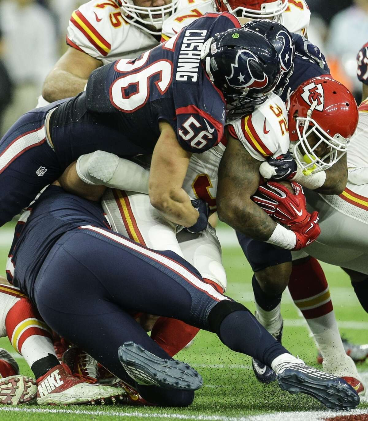 Houston Texans inside linebacker Brian Cushing (56) tackles Kansas City Chiefs running back Spencer Ware (32) after a 2-yard gain during the second quarter of the AFC Wildcard playoff game at NRG Stadium on Saturday, Jan. 9, 2016, in Houston. ( Brett Coomer / Houston Chronicle )
