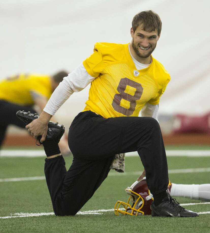 Washington Redskins quarterback Kirk Cousins stretches during practice at the team's NFL training facility at Redskins Park, on Friday, Jan. 8, 2016, in Ashburn, Va. The Washington Redskins will play the Green Bay Packers in a wild-card game on Sunday. (AP Photo/Evan Vucci) Photo: Evan Vucci, Associated Press