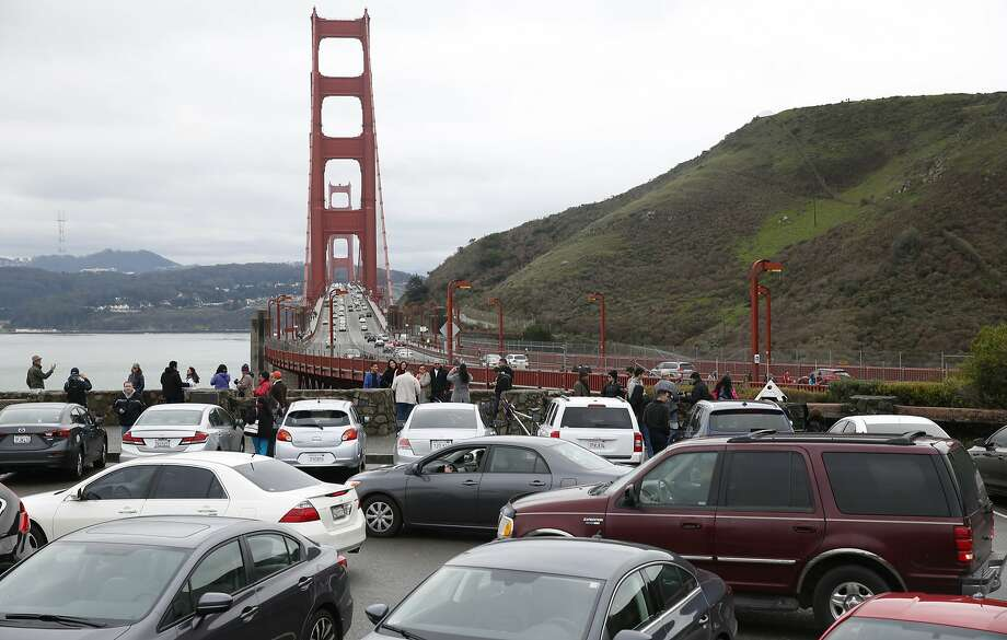 Motorists waiting for parking spaces to open up create a logjam at the north vista point of the Golden Gate Bridge in Sausalito, Calif. on Saturday, Jan. 9, 2016. During peak times, northbound traffic attempting to exit into the vista point's parking lot often backs up, creating significant congestion coming off the bridge. Photo: Paul Chinn, The Chronicle