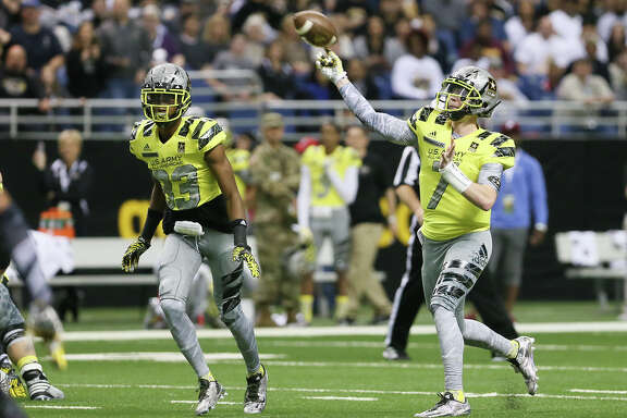 West quarterback Shea Patterson (right) throws a pass during the first half of the U.S. Army All-American Game at the Alamodome on Saturday, Jan. 9, 2016. Patterson was named the game's Most Valuable Player.