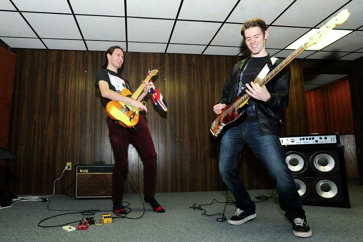 Kalimur guitarist Alex Touern-Trend, left, and bassist Tyler Berkich practice in Greenwich before their concert in New York City on Jan. 9, 2016. The Greenwich-based alternative rock band is releasing their second album