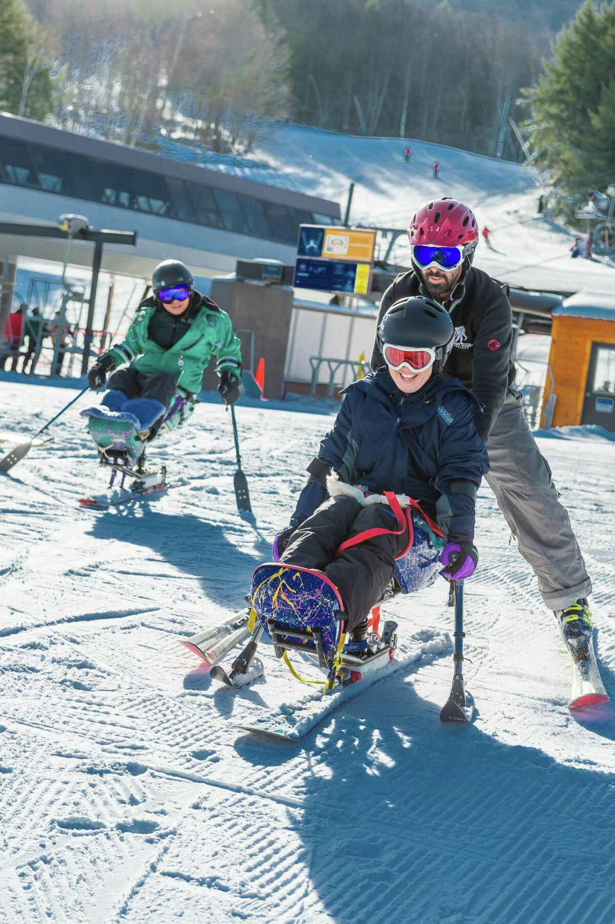 Adaptive Sports Foundation presented its Wounded Warriors Weekend at Windham Mountain on Friday Jan. 8, 2016. Seen here are Rachel Fredericks, Wounded Warrior of Troy and volunteer instructors I Tai Lu and Kevin Gray. (Photo by March Bryan-Brown Photography)