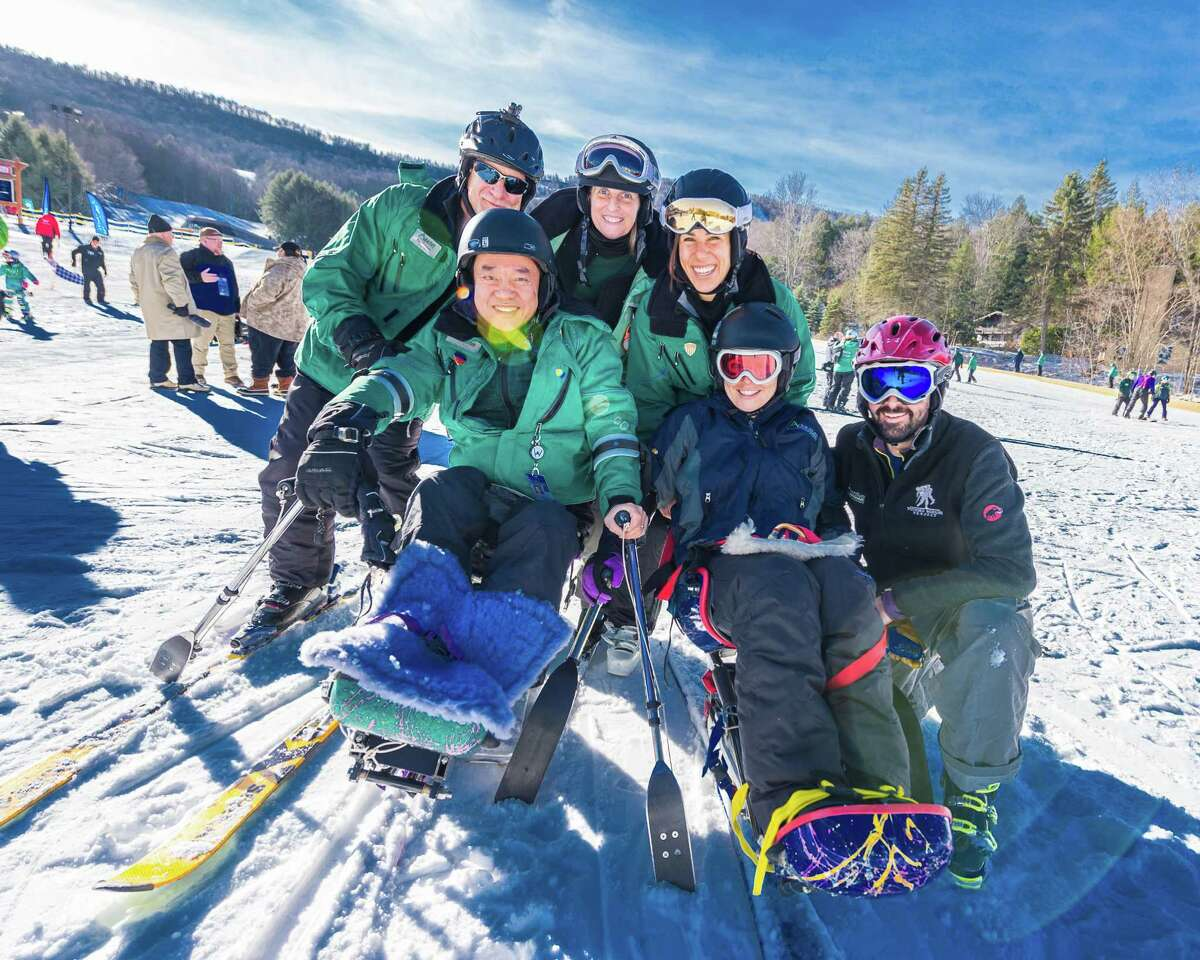 Adaptive Sports Foundation presented its Wounded Warriors Weekend at Windham Mountain on Friday Jan. 8, 2016. Seen here are Rachel Fredericks, Wounded Warrior of Troy and volunteer instructors I Tai Lu, Ron DiMecili, Kevin Gray, Mary Bozzone. (Photo by March Bryan-Brown Photography)