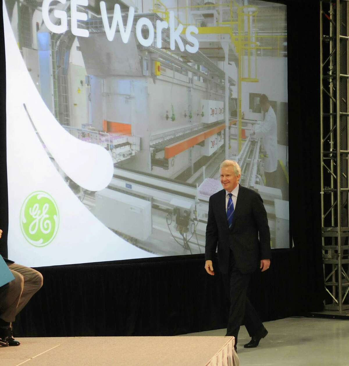 Jeffrey Immelt, GE chairman and CEO, makes his way to the stage at the opening of the company's new battery plant on Tuesday, July 10, 2012 at the GE campus in Schenectady, NY. The plant will use GE's durathon battery technology in manufacturing batteries for industry. (Paul Buckowski / Times Union)
