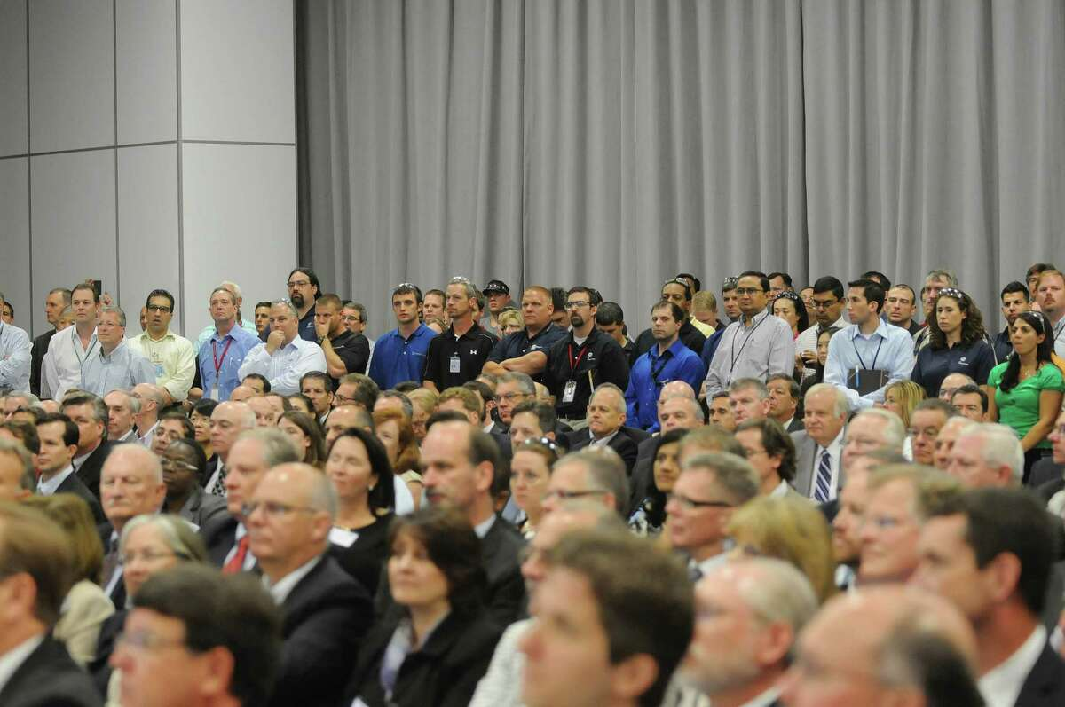 GE employees along with visitors listen as Jeffrey Immelt, GE chairman and CEO, addresses them at the opening of the company's new battery plant on Tuesday, July 10, 2012 at the GE campus in Schenectady, NY. The plant will use GE's durathon battery technology in manufacturing batteries for industry. (Paul Buckowski / Times Union)