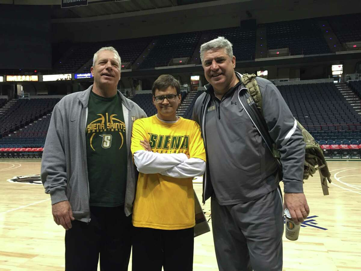 Siena coach Jimmy Patsos, right, is shown with his nephew, Derek Patsos, middle, and Chris Patsos, who is Derek's father and Jimmy's brother. (Pete Iorizzo / Times Union)