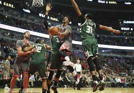 The Chicago Bulls' Jimmy Butler (21) scores past the Milwaukee Bucks' Giannis Antetokounmpo (34) during the first half at the United Center in Chicago on Tuesday, Jan. 5, 2016. (Nuccio DiNuzzo/Chicago Tribune/TNS)