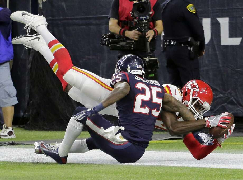 Chiefs wide receiver Chris Conley catches a touchdown pass over Houston Texans cornerback Kareem Jackson (25) during the second half of their AFC wild-card playoff game in Houston. Photo: Austin Gay, Associated Press