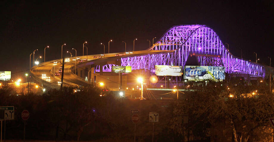 On Nov. 30, 2011, residents got a sneak peek of the Corpus Christi's Harbor Bridge's new programmable $2.2 million lighting system, which included 950 LED lights that cover the bridge in a array of colors and patterns. The bridge opened in 1959. Photo: Corpus Christi Caller-Times File Photo / Corpus Christi Caller-Times