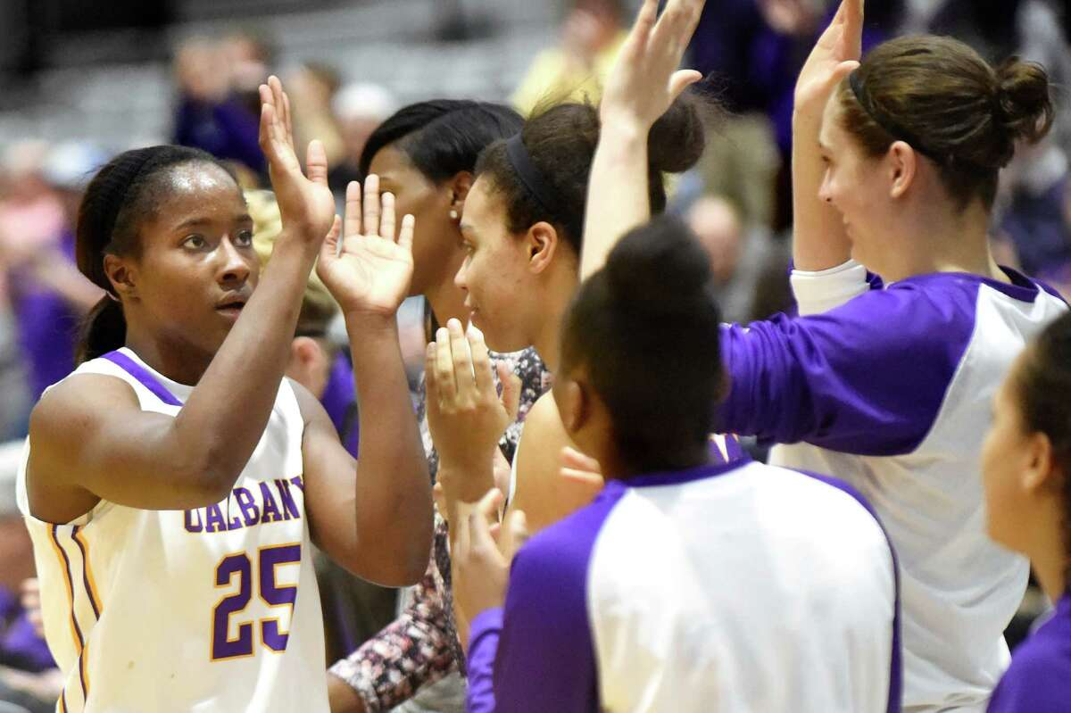 UAlbany's Shereesha Richards, left, celebrates reaching 2,000 career points with teammates during their basketball game against Vermont on Saturday, Jan. 9, 2016, at SEFCU Arena in Albany, N.Y. (Cindy Schultz / Times Union)