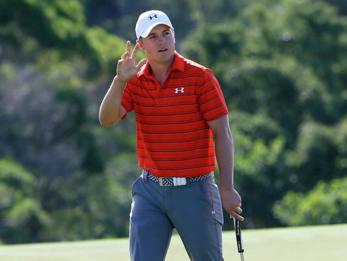Jordan Spieth reacts to making his eagle putt on the 18th green during the third round of the Tournament of Champions golf tournament, Saturday, Jan. 9, 2016, at Kapalua Plantation Course on Kapalua, Hawaii. (AP Photo/Matt York) ORG XMIT: HIMY123