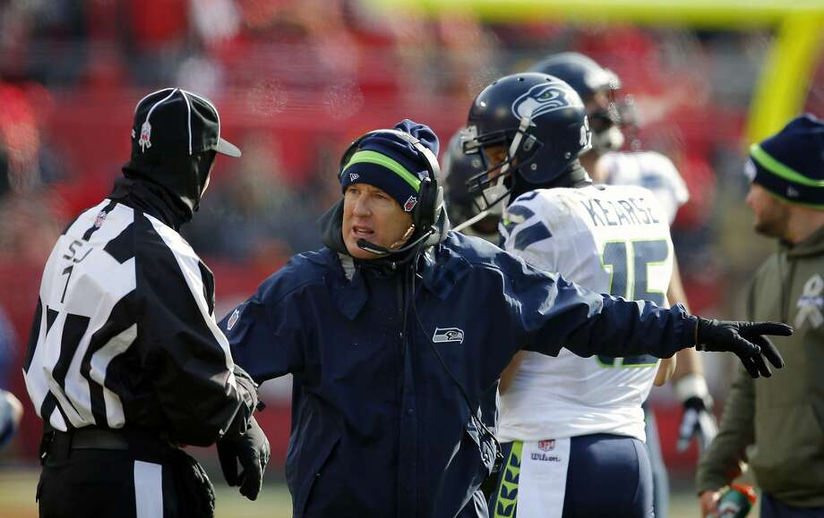 FILE - In this Nov. 16, 2014, file photo, Seattle Seahawks head coach Pete Carroll, center, argues a call in the first half of an NFL football game against the Kansas City Chiefs in Kansas City, Mo. The Seahawks played at Kansas City when it was 21 degrees, the coldest game they have played in since Carroll became head coach in 2010. (AP Photo/Ed Zurga, File) Photo: Ed Zurga, Associated Press