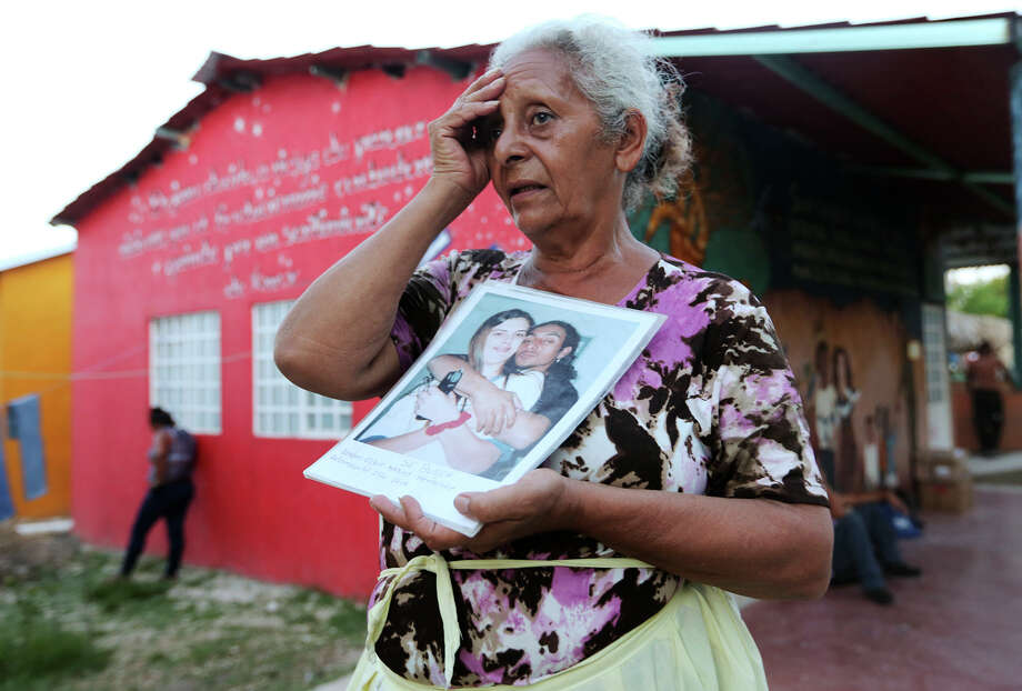 "Blanca Lydia Valenzuela, 60, of Honduras, talks about her missing son while staying at La 72 immigrant shelter in Tenosique, Mexico, Wednesday, August 8, 2014. Her son went missing in 2003 while trying to make his way back into the U.S. He was living in New Orleans at the time of his deportation. Valenzuela has ridden the train and on buses searching for her son since 2004. The son left a pregnant girlfriend who called them after his disappearance. ""She spoke English and no one could understand her,"" she said. Photo: Jerry Lara, Staff / San Antonio Express-News / @San Antonio Express-News"